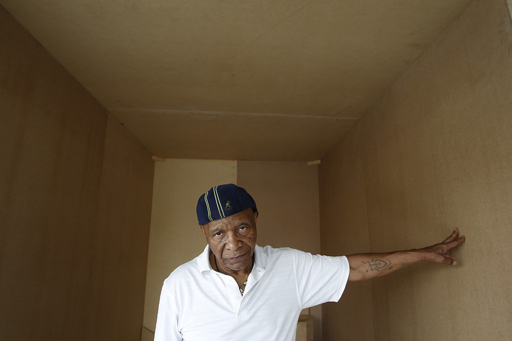 Robert King in replica cell. Photo by Chris Granger, The New Orleans Times-Picayune.