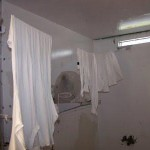 View of a home-made clothesline in a cell (Source: http://minutesbeforesix.blogspot.com)