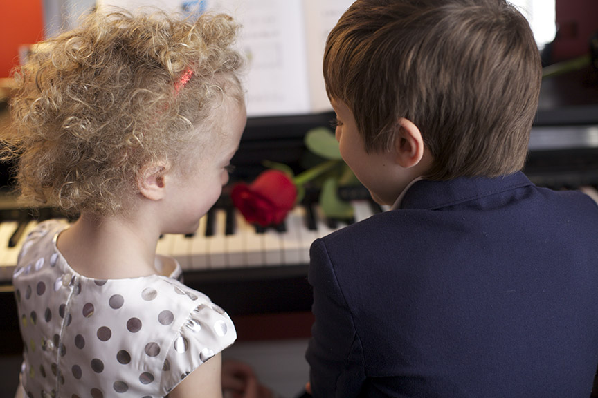 TWO CHILDREN AT THE PIANO—Photo by Karen Rodriguez