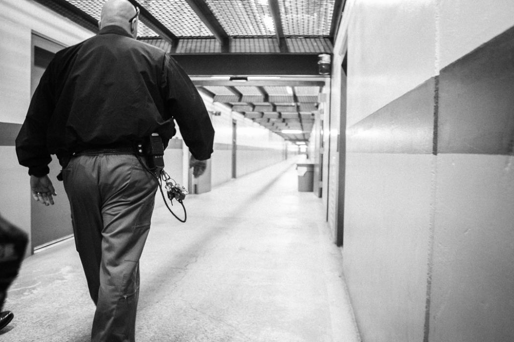 Capt. Dave Barneburg, a prison gang investigator, walks down a SHU corridor at PBSP. [Del Norte Triplicate SLASH Bryant Anderson]
