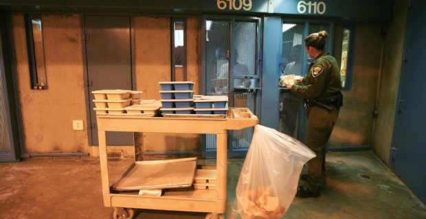 PBSP - a Prison officer passes out food in the general population section of PBSP -- Jim Wilson, The New York Times