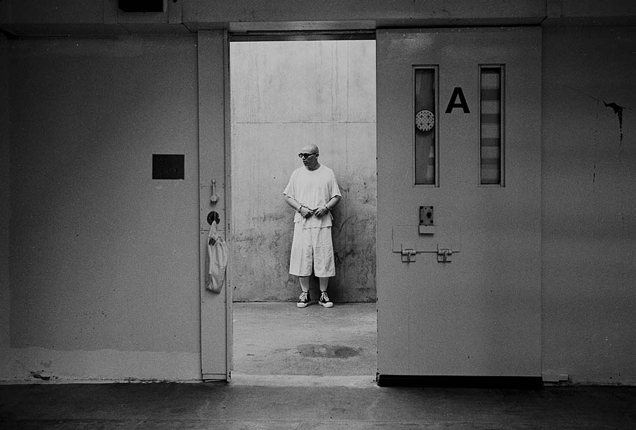A prisoner in the recreations area, where he is permitted highly controlled exercise (Credits: Los Angeles Times)