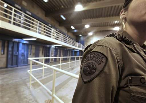 A PBSP correctional officer makes rounds at a Security Housing Unit