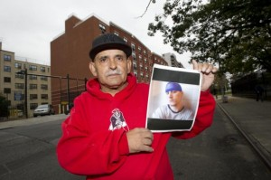 Ramon Echavarria with a picture of his son, Jason, who died on Rikers Island in 2012. Photo: Howard Simmons, NY Daily News
