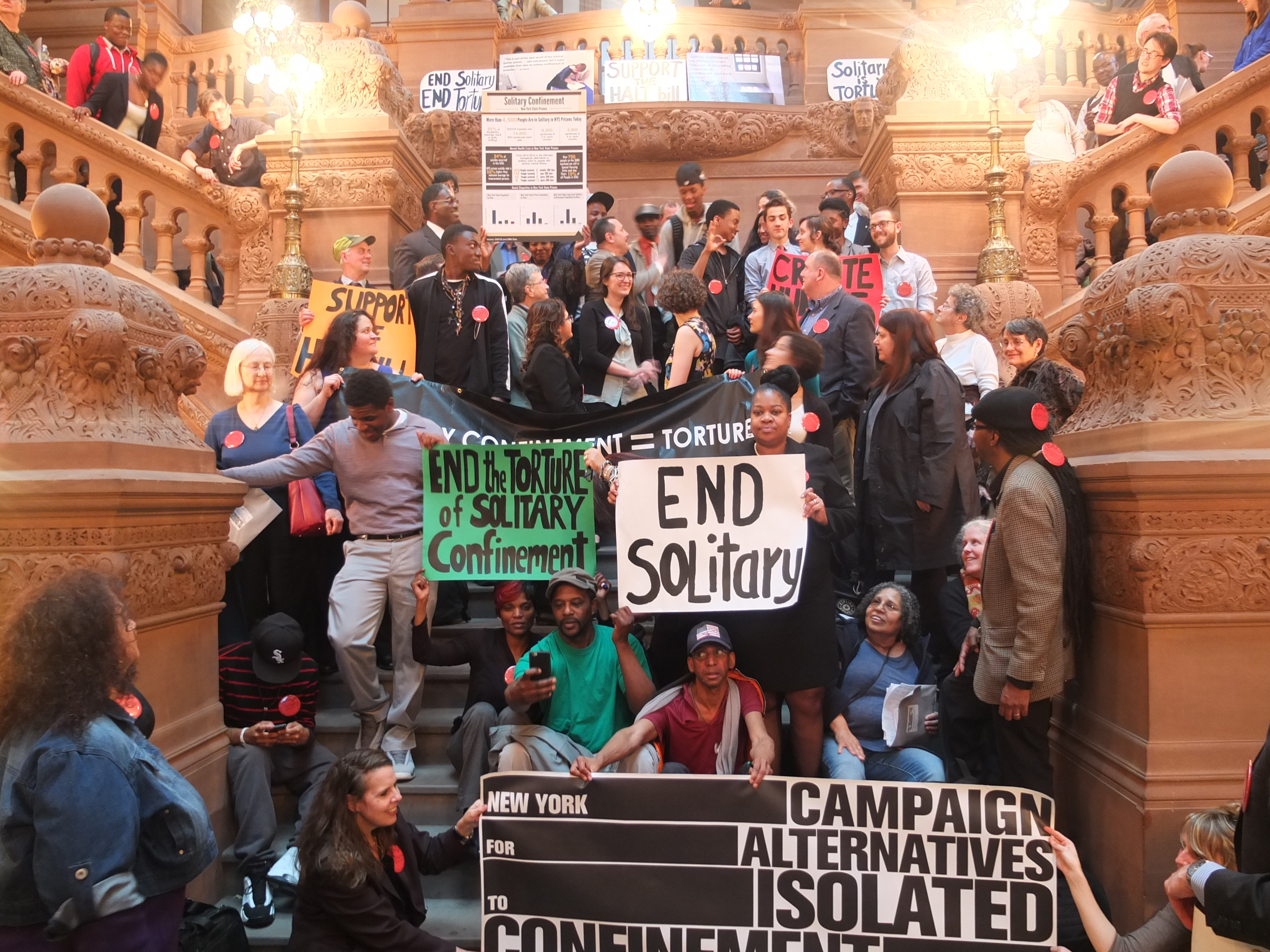 Activists rally in the New York State Capitol after a day of lobbying for the HALT Solitary Confinement Act.