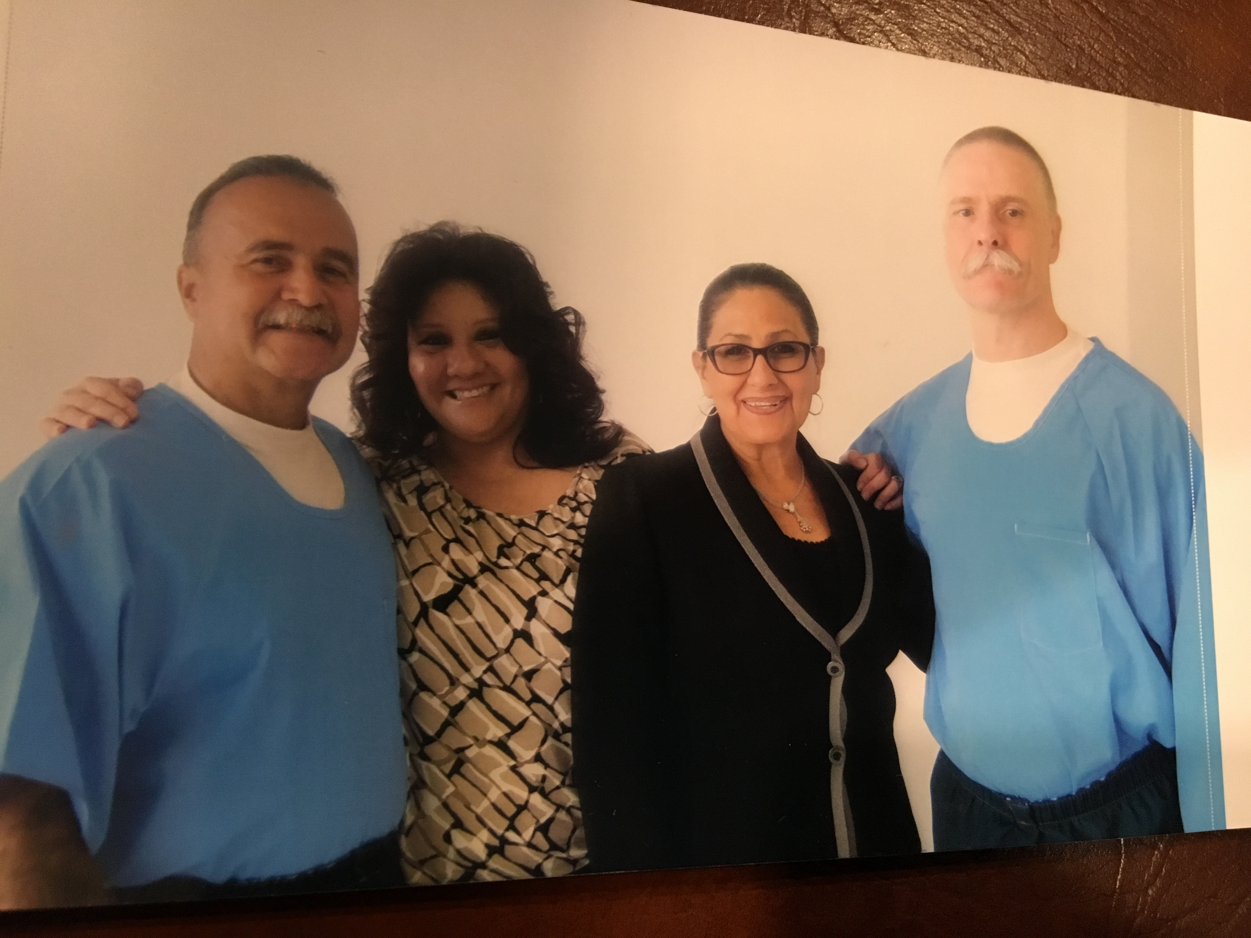 "Gabriel Huerta (left) and Todd Ashker, who helped lead the Pelican Bay hunger strikes, with Huerta's wife Irene and advocate Dolores Canales at Kern Valley State Prison. This was Ashker's first ""contact visit"" in more than 30 years."