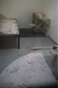 After attempting suicide, a man was returned the next day to his E Wing cell, still spattered with his blood.
