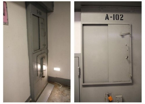Metal doors with shielded windows to an SMU cell