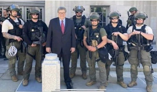In a photo obtained by the Huffington Post's Ryan Reilly, Attorney General Bill Barr poses with a BOP SORT team outside the Justice Department's headquarters in Washington, D.C.