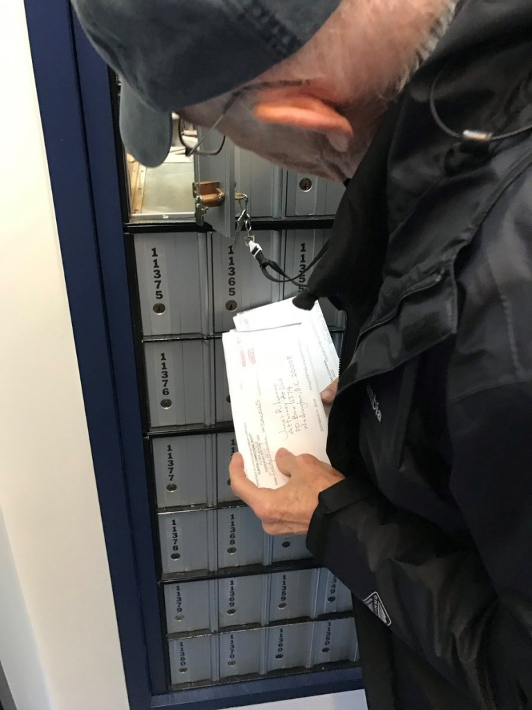 Jim's friend, the journalist Jeremy Young, snapped this picture a few years ago as Jim picked up mail at the Solitary Watch PO box.